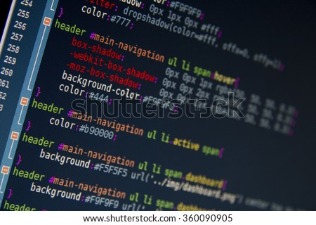 HTML CSS3 source code on lcd screen with black background. Web development and programming with computer CSS, JavaScript and HTML code. Information technology website coding standards for web design - stock photo