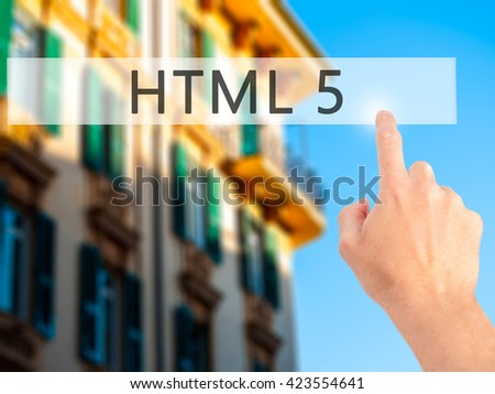 HTML 5 - Hand pressing a button on blurred background concept . Business, technology, internet concept. Stock Photo - stock photo