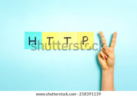 HTTP 2. Hand making V sign gesture, success symbol, on blue background. - stock photo