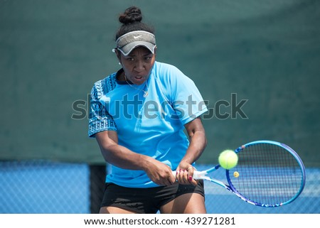 HUA HIN, THAILAND-APRIL 13:Abigail Tere-Apisha of Papua New Guinea returns a ball during Day 3 of Fed Cup by BNP Paribas on April 13, 2016 at True Arena Hua Hin in Hua Hin, Thailand