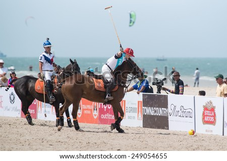 HUA HIN, THAILAND - APRIL 19: France Polo Team (L) plays against Thai Polo Team (R) during 2014 Beach Polo Asia Championship on April 19 2014 in Hua Hin, Thailand. France Polo Team wins 2-1. - stock photo