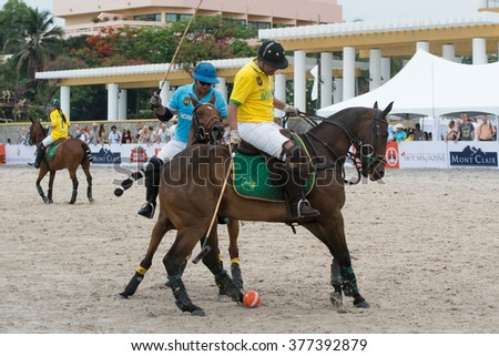 HUA HIN, THAILAND - APRIL 25: Hong Kong Polo Team (blue) plays against Macau Polo Team (yellow) during 2015 Beach Polo Asia Championship on April 25, 2015 in Hua Hin, Thailand.