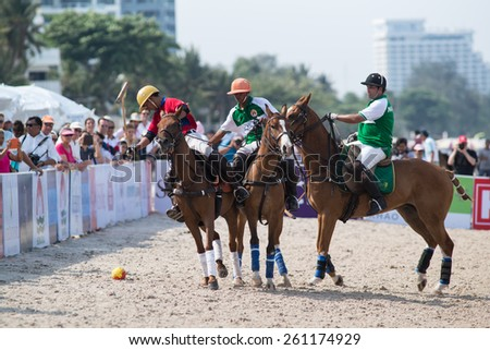 HUA HIN, THAILAND - APRIL 19: Hong Kong Polo Team (white-red) plays against Macau Polo Team (white-green) during 2014 Beach Polo Asia Championship on April 19 2014 in Hua Hin, Thailand. - stock photo