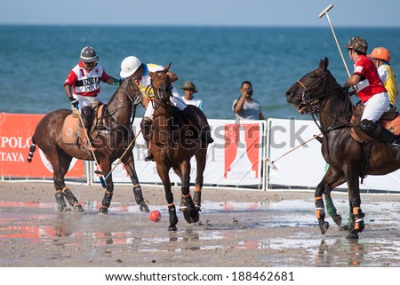 HUA HIN, THAILAND - APRIL 21: India Polo Team (red) plays against Hong Kong Polo Team (yellow) during 2013 Beach Polo Asia Championship on April 21 2013 in Hua Hin, Thailand. India Polo Team wins 4-2. - stock photo