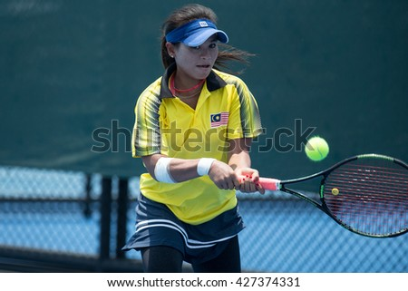 HUA HIN, THAILAND-APRIL 12:Jawairiah Noordin of Malaysia returns a ball during Day 2 of Fed Cup by BNP Paribas on April 12, 2016 at True Arena Hua Hin in Hua Hin, Thailand