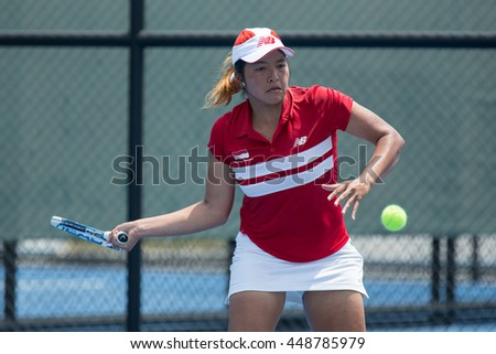 HUA HIN, THAILAND-APRIL 14:Jessy Rompies of Indonesia returns a ball during Day 4 of Fed Cup by BNP Paribas on April 14, 2016 at True Arena Hua Hin in Hua Hin, Thailand