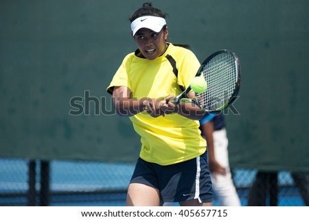 HUA HIN, THAILAND-APRIL 12:Nurin Nabilah Roslan of Malaysia returns a ball during Day 2 of Fed Cup by BNP Paribas on April 12, 2016 at True Arena Hua Hin in Hua Hin, Thailand