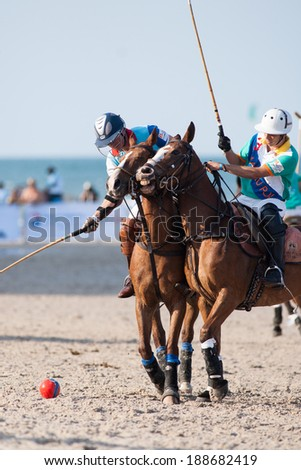 HUA HIN, THAILAND - APRIL 21: Thai Polo Team (L) plays against Macau Polo Team (R) during 2013 Beach Polo Asia Championship on April 21 2013 in Hua Hin, Thailand. Thai Polo Team wins 5-2. - stock photo