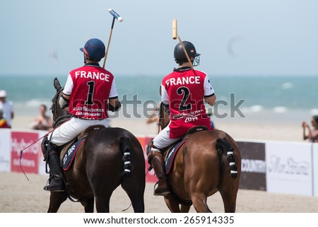 HUA HIN, THAILAND - APRIL 19: Two unidentified players of France Polo Team in action during 2014 Beach Polo Asia Championship on April 19 2014 in Hua Hin, Thailand. - stock photo