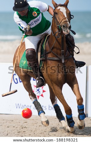 HUA HIN, THAILAND - APRIL 19: Unidentified player of Macau Polo Team in action during 2014 Beach Polo Asia Championship on April 19 2014 in Hua Hin, Thailand. France Polo Team wins 8-4. - stock photo
