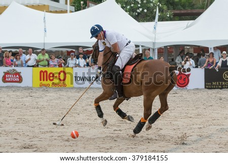 HUA HIN, THAILAND - APRIL 25: Unidentified Thai Polo Team player in action during 2015 Beach Polo Asia Championship on April 25, 2015 in Hua Hin, Thailand. - stock photo
