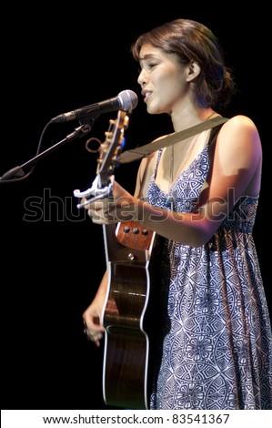 HUA HIN, THAILAND - AUGUST 27: Kina Grannis performs at the Hua Hin Jazz Festival on August, 27, 2011 in Hua Hin, Thailand. - stock photo