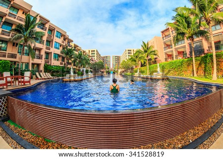 "HUA HIN, THAILAND - DEC 14: Main pool of Marrakech Hotel on Dec 14, 2014 in Hua Hin. The design of the hotel was Inspired by rich and colorful culture of Morocco's Marrakech or ""a city of red""."