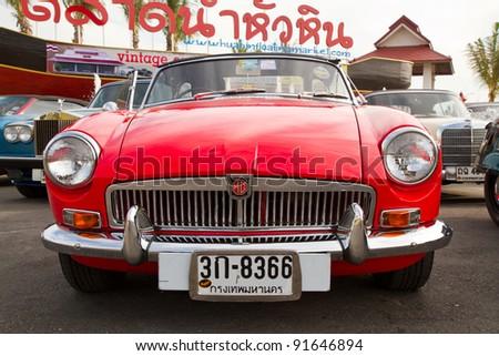 HUA HIN, THAILAND - DEC 16: 1960s MG MGB  Vintage cars display in Hua Hin Vintage Cars Parade Festival 2011 at Hua Hin floating market on December 16, 2011 in Hua Hin, Thailand. - stock photo