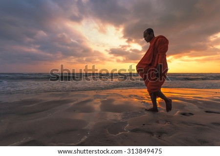 HUA-HIN, THAILAND - DEC 11: Unidentified Buddhist monks walk for people offering food in the early morning on December 11, 2011. Offering food is one of most common rituals in Buddhism. - stock photo