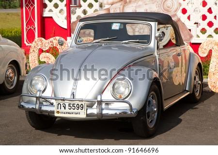 HUA HIN, THAILAND - DEC 16: Volkswagen VW Beetle, RHD Vintage cars display in Hua Hin Vintage Cars Parade Festival 2011 at Hua Hin floating market on December 16, 2011 in Hua Hin, Thailand. - stock photo