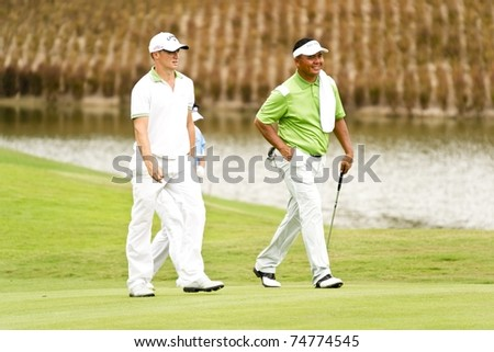 HUA HIN, THAILAND - DECEMBER 16: Alex Noren (L) and Mardan Mamat (R) walk towards 9th hole on Day 1 of Black Mountain Masters 2010 on December 16, 2010 at Black Mountain Golf Club in Hua Hin, Thailand