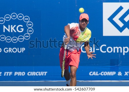 HUA HIN, THAILAND-DECEMBER 24:Daniel Altmaier of Germany serves during final match of ITF Pro Circuit Thailand Men's F5 on December 24, 2016 at True Arena Hua Hin in Hua Hin, Thailand