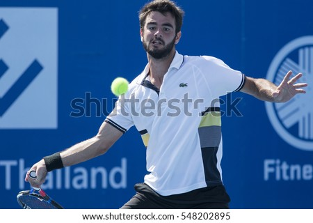 HUA HIN, THAILAND-DECEMBER 31:Fabien Reboul of France returns a ball during final match of ITF Pro Circuit Thailand Men's F6 on December 31, 2016 at True Arena Hua Hin in Hua Hin, Thailand