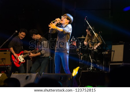 HUA HIN, THAILAND - DECEMBER 31 : Lead singer of Musketeers rock band performs live concert during Hua Hin Music Countdown 2013 on  December 31, 2012 in Hua Hin, Prachuapkhirikhan, Thailand - stock photo