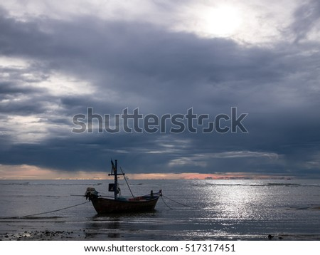 HUA HIN THAILAND : fishing boat and dark cloud rain on sunrise time