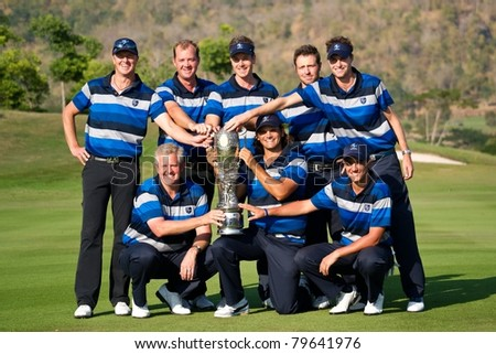 HUA HIN, THAILAND - JANUARY 9: European team pose with the trophy as they win the tournament on day 3 of The Royal Trophy Europe VS Asia on January 9, 2011 at Black Mountain Golf Club in Hua Hin, Thailand - stock photo