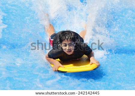 Hua Hin, Thailand - January 2:  Unidentified  tourists enjoy playing with water at the Asia's first water jungle Vana Nava, on January 2, 2015 at the Hua Hin, Thailand. - stock photo
