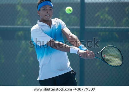 HUA HIN, THAILAND-JUNE 6:Alisher Nosirov of Uzbekistan returns a ball during Day 1 of The QuantGroup ATT Thailand M3 on June 6, 2016 at True Arena Hua Hin in Hua Hin, Thailand
