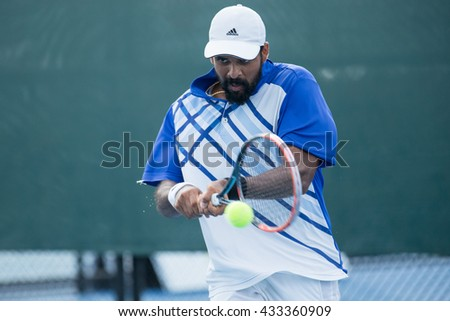 HUA HIN, THAILAND-JUNE 7:Vishnu Vardhan of India returns a ball during Day 2 of The Quant Group ATT Thailand M3 on June 7, 2016 at True Arena Hua Hin in Hua Hin, Thailand