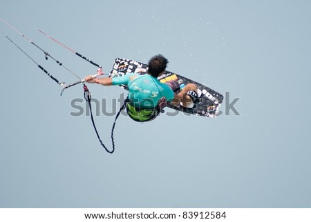 HUA HIN, THAILAND - MARCH 16: PKRA Freestyle rider Cesar Portas of Spain competes during the 2010 Hua Hin Kiteboard World Cup on March 16, 2010 at Hua Hin Beach in Hua Hin, Thailand
