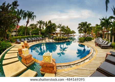 HUA HIN, THAILAND - MAY 13: Swimming Pool of Wora Bura Hotel May 13, 2016 in Hua Hin. It was designed as Thai-Colonial style concept, situated along 75 metres of beachfront of Hua HIn.
