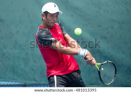 HUA HIN, THAILAND-SEPTEMBER 9:Jumpei Yamasaki of Japan returns a ball during Day 5 of ITF Pro Circuit Thailand Men's F3 on September 9, 2016 at True Arena Hua Hin in Hua Hin, Thailand