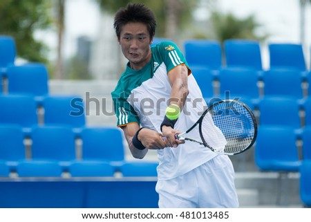 HUA HIN, THAILAND-SEPTEMBER 9:Wishaya Trongcharoenchaikul of Thailand returns a ball during Day 5 of ITF Pro Circuit Thailand Men's F3 on September 9, 2016 at True Arena Hua Hin in Hua Hin, Thailand
