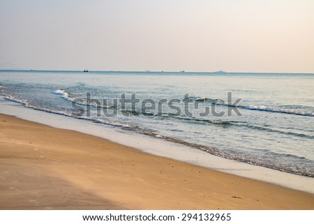 Huahin beach brown sand wave beautiful nature at morning be fresh cool relaxing, prachuapkhirikhan, thailand - stock photo