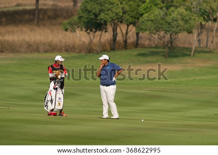 HUAHIN, THAILAND-FEBRUARY 12: Seukhyun Baek of South Korea and caddy during Round 1 of 2015 True Thailand Classic on February 12, 2015 at Black Mountain Golf Club in Hua Hin, Thailand