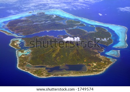 huahine island in French Polynesia, with airport in foreground - stock photo