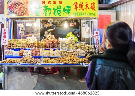 Hualien, Taiwan - Marth 15, 2016: Vendor prepares food at the Dongdaemun night market located in Hualien City.
