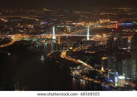 Huangpu River and Nanpu Bridge at night. Shanghai, China - stock photo