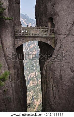 Huangshan. Stone bridge in the mountains of China. - stock photo