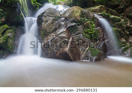 Huay Kaew waterfall deep in the jungle in Chiang Rai, Thailand. - stock photo