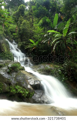 Huay Kaew Waterfall, Paradise waterfall in Tropical rain forest of Thailand , deep forest water fall in Chaingrai  - stock photo