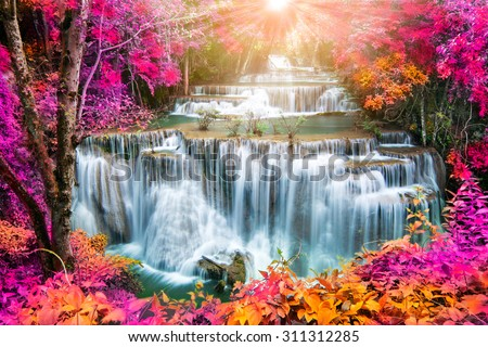 Huay Mae Kamin Waterfall, beautiful waterfall in autumn forest, Kanchanaburi province, Thailand  - stock photo