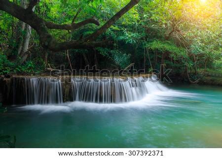 Huay Mae Kamin Waterfall, beautiful waterfall in deep forest, Kanchanaburi province, Thailand - stock photo