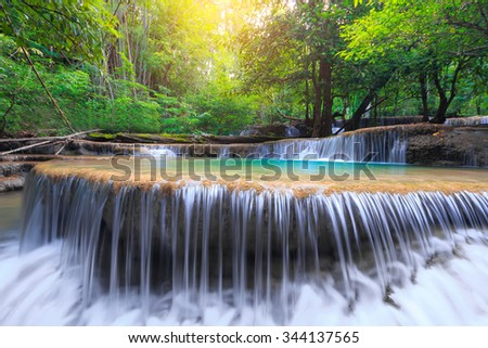 Huay Mae Kamin Waterfall, beautiful waterfall in rainforest, Kanchanaburi province, Thailand - stock photo
