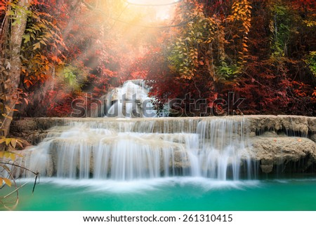 Huay Mae Kamin Waterfall with ray light, beautiful waterfall in deep forest, Kanchanaburi in Thailand - stock photo