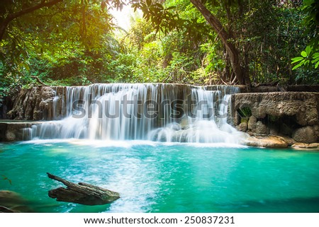 Huay Mae Khamin waterfall with day noon light in tropical forest, Thailand - stock photo