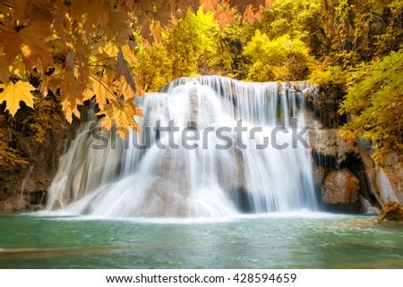 Huay MaeKamin Waterfall is beautiful waterfall in autumn forest, Kanchanaburi province, Thailand.  - stock photo
