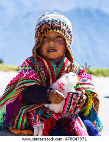 Huayllabamaba Peru -May 18 : young boy dressed in traditional native Peruvian clothing posing for a tip. May 18 2016, Huayllabamaba Peru.