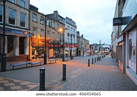 HUDDERSFIELD, UK - APRIL 16, 2016: Pedestrianised street. Huddersfield is a large market town and the largest settlement in the metropolitan borough of Kirklees, West Yorkshire, - stock photo