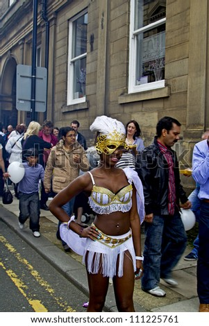 HUDDERSFIELD, UK - JULY 14: Participant in the Huddersfield 28th Annual Caribbean Carnival, 14, July 2012.  The Carnival is becoming one of the largest and most celebrates festivals in West Yorkshire